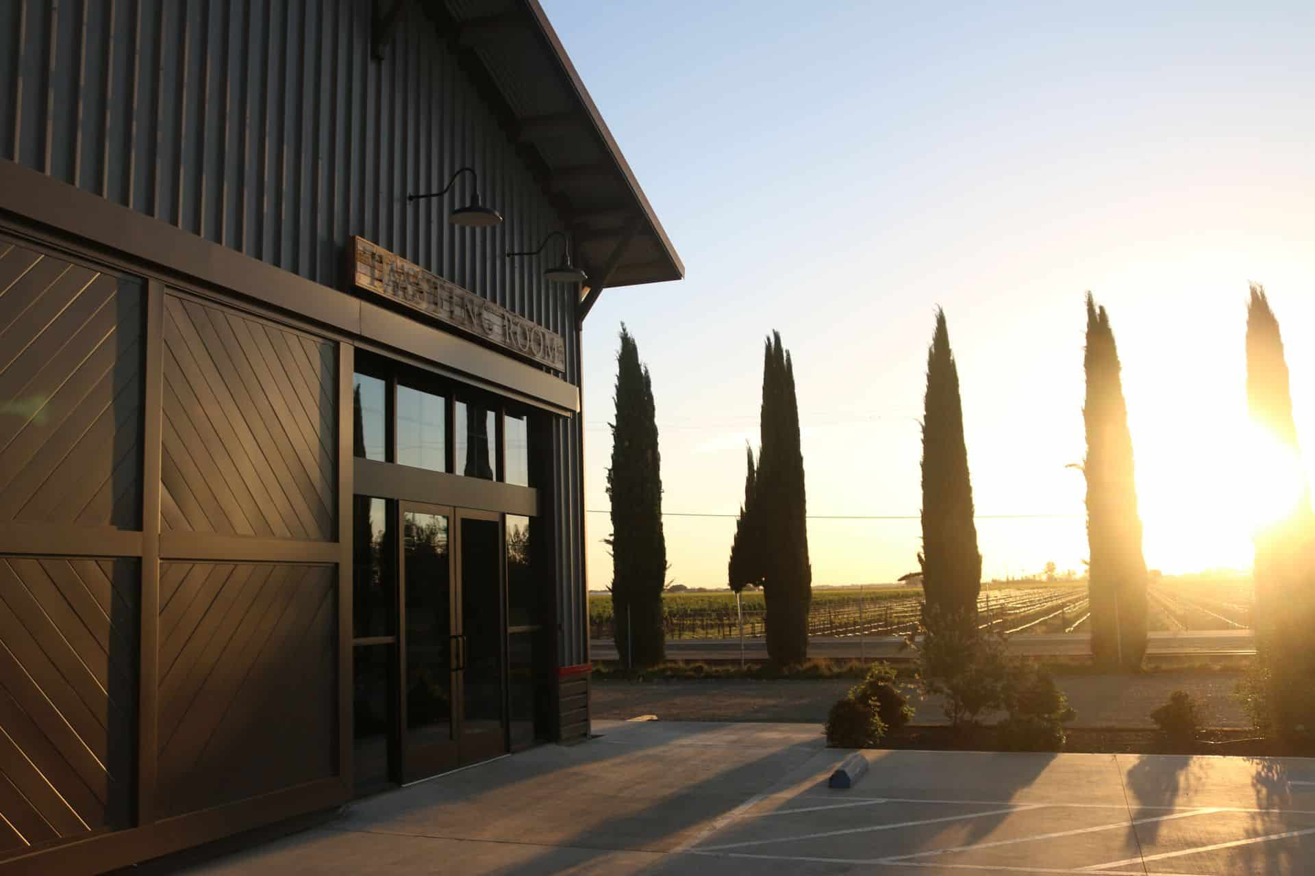 photo of outside entrance to peltier winery tasting room at sunset