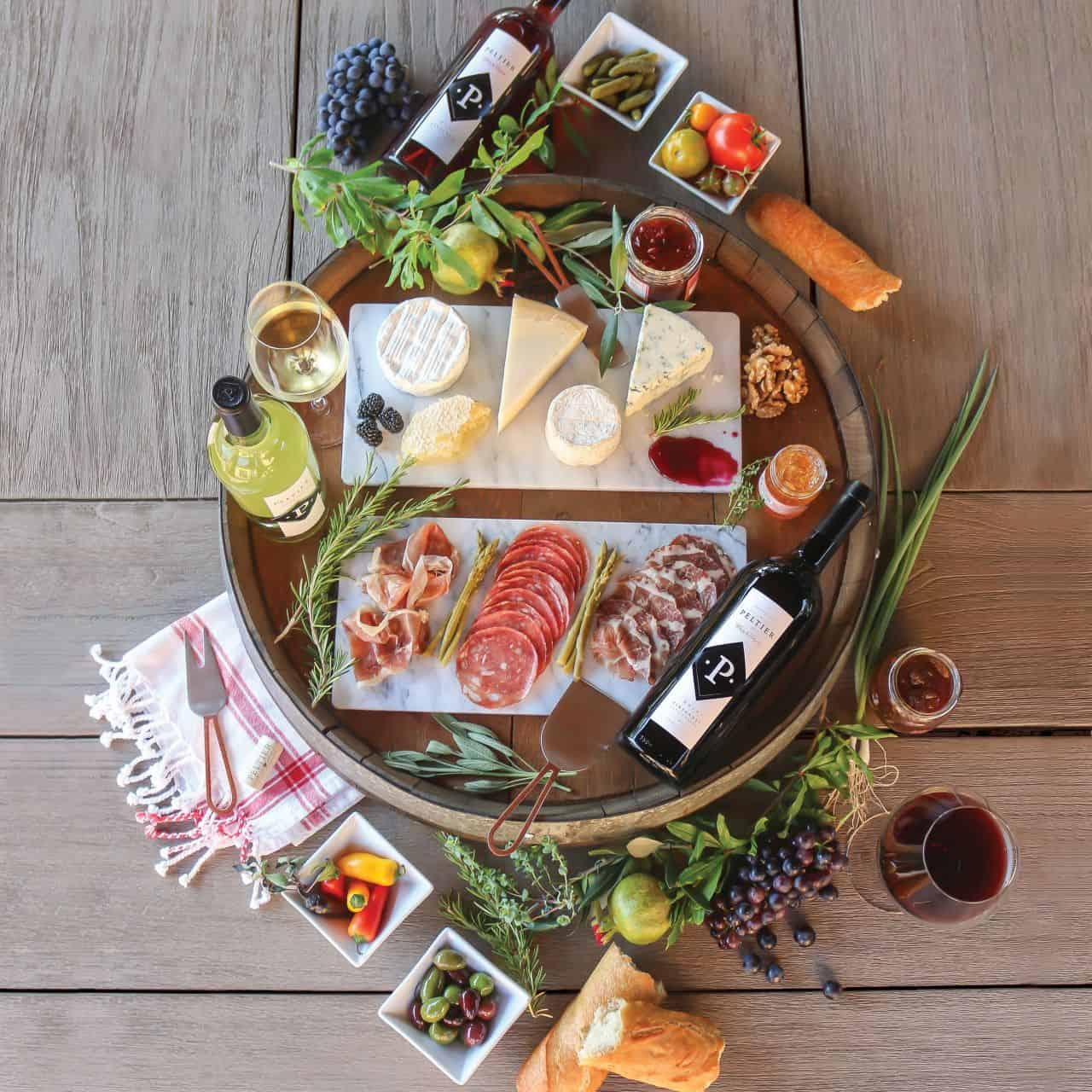 charcuterie board from above with meats, cheeses and wine
