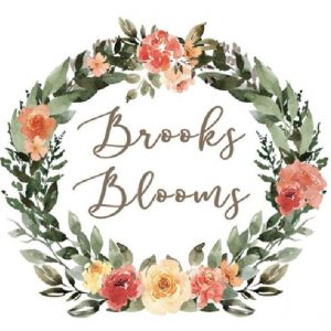 brooks blooms logo wreath with green leaves and roses