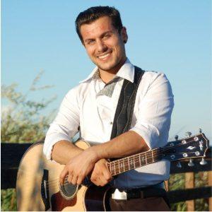 Dustin Heer holding guitar