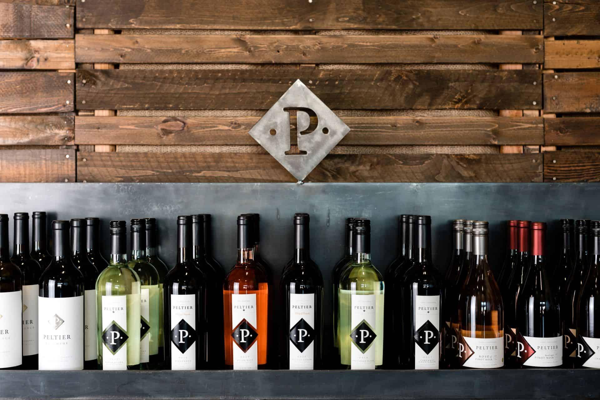 peltier wine bottles with wood background