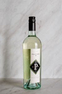 bottle of sauvignon blanc on a white marble background