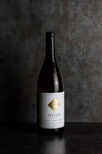 bottle of winemaker Select Chardonnay with grey metal background