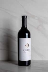 Bottle of 2016 Red Blend on white marble background
