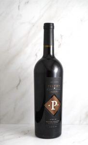 Native Old Vine Zinfandel bottle on white marble background